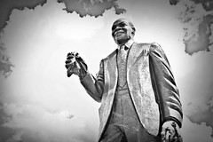 Louis Armstrong Statue in Armstrong Park --- New Orleans (forestforthetress) Tags: louisarmstrong satchmo bw blackandwhite omot nikon statue monochrome jazz music musician sky man people