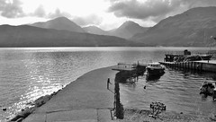 Inversnaid Pier & the Arrochar Alps (brightondj - getting the most from a cheap compact) Tags: scotland trossachs lochlomond loch water mountains pier boat boats ferry harbour bw arrocharalps