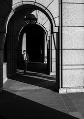 Ricochet (Rupert Vandervell) Tags: street city shadow sun white man black building london texture lines sunshine stone wall architecture contrast walking shadows bright pavement geometry vibrant shapes tie atmosphere pedestrian olympus suit sidewalk human rupert em5 vandervell