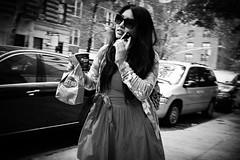 murray's bagels (omoo) Tags: newyorkcity bw girl cellphone reddress streetscenes greenwichvillage brownbag bwphotograph murraysbagels girlinreddress takeoutcoffee prettygirlinred girlwithacellphone coffeeandabagel west12thstreetnearsixthavenue