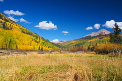 The Beauty of the San Juans (RobertCross1 (off and on)) Tags: autumn trees sky mountains fall beauty clouds fence landscape colorado bluesky olympus foliage sanjuan omd m43 mft