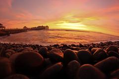 Down by the Pier, Makaha (Geraint Rowland Photography) Tags: travel sunset red sun fish sol beach peru canon surf waves shine lima fisheye shore surfers miraflores sundried makaha