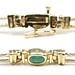 1047. Two Color Gold and Gem Set Bracelet