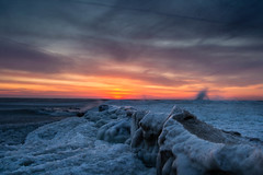 a sea of ice (olsonj) Tags: morning light ice beach water wisconsin clouds sunrise dawn waves lakemichigan kenosha