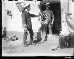 Officer with wreath on HMAS AUSTRALIA I (Australian National Maritime Museum on The Commons) Tags: 1920s destruction navy sydney sailors wreath ratings hood sunk naval cruiser 1924 personnel gardenisland officers flagship decommissioned battlecruiser royalaustraliannavy scuttled sydneyheads navalvessel hmasaustralia hoodcollection indefatigableclass samueljhoodcollection