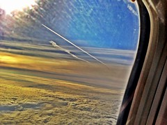 Vapour trail............. (Pro-tography) Tags: uk travel blue light england sky fling window clouds plane denmark fly high airport control box ryan 5 seat air wing jet engine fluffy craft terminal passengers landing jetstream tip crew journey take boeing passport scape pilot stansted iphone pressurized 2013