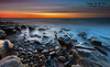 Bar Beach Newcastle NSW Australia (Kiall Frost) Tags: ocean longexposure blue red orange sun color colour water clouds sunrise newcastle rocks australia nsw barbeach kiallfrost wwwkiallfrostcomau