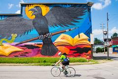 The Crow (sniggie) Tags: kentucky louisville sobersolutionsbuilding artistwilfredsiegiii shelbyparkneighborhood germantown bicycle bicyclist change believeinyourself alchoholism liveandletlive streetphotography