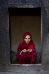 Portrait of an afghan girl with pale skin wearing red clothes, Badakhshan province, Khandood, Afghanistan (Eric Lafforgue) Tags: 1213years 1314years afghan afghan508 afghani afghanistan anthropolgy badakhshanprovince beautiful centralasia colourimage community fullframe headscarf indigenousculture indoors ismaili khandood lifestyles lookingatcamera oneperson oneteenagegirlonly photography portrait poverty red scarf sitting teenager traditionalclothing veil vertical waistup wakhan wakhi pamir