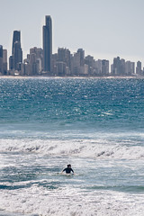 Surfer's Paradise (Konrad Kasperski) Tags: beach australia goldcoast buildings water ocean waves surfer surf foam blue