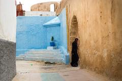 Morocco (fredcan) Tags: maroc morocco northernafrica maghreb essaouira medina oldtown walls colourful street woman moroccan local walking passing djellaba black alone travel