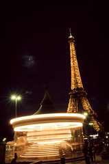 Game under the Tower (RedaGraphy) Tags: longexposure travel light game paris france childhood night nikon carousel eiffel toureiffel entertainement manege hollidays d5100