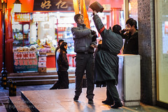 A Little Friendly Street Fight (Russ Beinder) Tags: china street night cn fun fight play market candid beijing