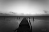 Bend (vincentchao) Tags: longexposure travel sea sky blackandwhite bw sun seascape reflection water beautiful clouds sunrise reflections landscape photography dock nikon soft belize horizon wide smooth peaceful calm caribbean tamron cayecaulker flickraward d7000 nikond7000 flickraward5