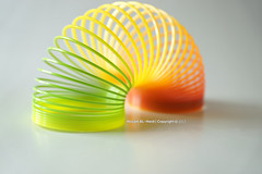 Slinky Colored (Hosam AL-Hwid) Tags: light red orange color green yellow toy toys sony slinky pure a77 hosam alhwid