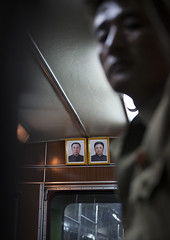 Official Portraits Of The Dear Leaders In A Metro Train, Pyongyang, North Korea (Eric Lafforgue) Tags: travel portrait people color colour men window station vertical architecture modern train asian photography town war asia publictransportation metro propaganda country capital illuminated communism forbidden indoors kimjongil photographs journey transportation subwaystation dailylife domesticlife oneperson northkorea onepeople humaninterest lifestyles pyongyang eastasia dprk lowlighting subwaytrain capitalcities colorimage kimilsung northkorean onlymen onemanonly lowangleview officialportrait 1people democraticpeoplesrepublicofkorea img6321 builtstructure vehicleinterior unrecognizableperson