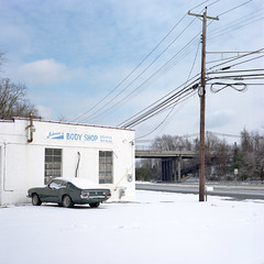 Johnnie's (Ben Hinceman) Tags: snow ford landscape overpass americana bodyshop maverick hasselblad500cm sociallandscape kodakportra160 zeiss80mm28