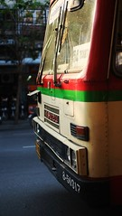 Front (andersdenkend) Tags: city windows urban sun reflection bus window thailand panel bokeh availablelight bangkok naturallight front depthoffield windshield wipers shining glas fujinonxf35mmf14 fujifilmxe1