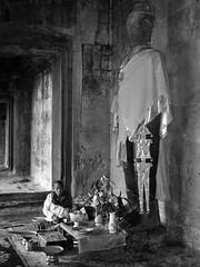 Offerings II (B&W) (jonhuskisson) Tags: travel temple worship asia cambodia southeastasia buddhist prayer angkorwat backpacking offering angkor wat placeofworship
