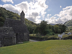 Glendalough, Eire - St. Kevin's Chapel (rayyaro) Tags: clouds skies churches eire chapels glendalough 1000 countywicklow stkevinsmonastery my1000thflickrphotograph