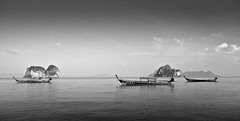 Thailand in Black & White (Matteo Allegro [www.matteoallegro.com]) Tags: travel sea sky white black clouds thailand boats island islands rocks tropical longtail trang andaman kongai waterscape bestcapturesaoi