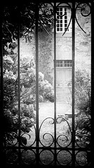 Untitled (cornishdjango photography) Tags: street travel bw france contrast pen silver garden photography blackwhite brittany gate secret olympus efex micro43rds epl3