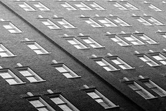 Windows & Bricks [Explored] (Darren LoPrinzi) Tags: street city windows light urban bw building brick philadelphia window monochrome architecture facade canon mono interestingness interesting pattern angle patterns bricks streetphotography angles diagonal explore pa gradient philly diagonals explored canoneos7d canon7d