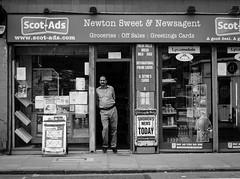 Newsagent (Duncan212) Tags: street people blackandwhite bw shop blackwhite edinburgh streetphotography newsagent acros gorgie gorgieroad