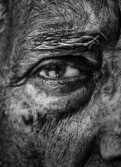 A shade of old. (Aakash.Sethi) Tags: eye old age man detail black white skin contrast pain hairs marks macro nose face features eyes light reflection