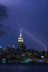 ([ raymond ]) Tags: manhattan nyc img5453 empirestatebuilding lightning bolt weather storm midtown river hudsonriver nature bluehour twilight dusk evening longexposure therebeastormabrewin
