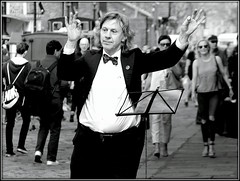 Mad Maestro (* RICHARD M (Over 5 million views)) Tags: street candid portraits portraiture streetportraits streetportraiture candidportraits candidportraiture mono blackwhite monochrome maestro madmaestro mad madness crazy crazyconductor conductor musician performer performance entertainer entertainment streetentertainer streetentertainment streetperformer streetperformance eccentric eccentricity wtf bowtie tailcoat characters wierd musicstand longhair longhaired longhairedconductor longhairedmaestro orchestralmanoeuvres albertdock liverpool merseyside unescocityofmusic odd oddball strange weirdo orchestraconductor thedecisivemoment lol