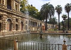 Alcazar Gardens (Hans van der Boom) Tags: europe spain vacation holiday seville sevilla alcazar palace gardens garden trees hedges green fence metal pond sp