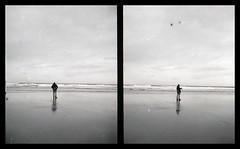 He Photographs the sea, then moves on [Pen EE] (Mr B's Photography) Tags: halfframe blackandwhite man beach sea sand