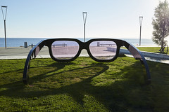 Bright and sunny day. (powerdook) Tags: sculpture glasses art artwork metal grass ocean water glass pink light sun summer aarhus denmark shadows