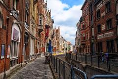 Street in Ghent, Belgium (` Toshio ') Tags: toshio ghent belgium gentsefesteen belgian europe european europeanunion street city cityscape architecture history rail shops stores buildings fujixe2 xe2 people