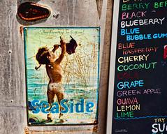 Seaside Suntan (grandalloliver) Tags: summer vacation signs canon seaside rust florida september topaz seasideflorida emeraldcoast canonefs1755mmf28usm southwaltoncounty hwy30a rebelxsi canonxsi topazadjust grandalloliver grandalloliverphoto beachesofsouthwaltoncounty