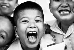 RAWWWR!!! (Angelo G.I.O.) Tags: school portrait people bw boys monochrome tongue kids youth work thailand outside outdoors happy 50mm blackwhite eyes nikon asia little bokeh availablelight bangkok young happiness rawr daytime monsters nikkor 18 naturalight thefuture breaktime littlemonsters d3000 bangkae nikond3000 totallythailand beyondbokeh phetkasemroad phetkasem phetkasem69 maneewattana