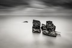 Emergence (the milster) Tags: longexposure sea blackandwhite clouds rocks kitlens devon torbay nikon1855mm d3100