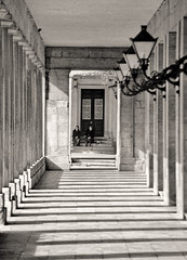 Resting in the Shade (h_roach) Tags: blackandwhite architecture island europe shadows columns greece balckandwhite lamps corfu twowomen corfutown traveldestination blackwhitephotos diamondclassphotographer flickrdiamond