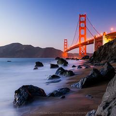Golden Gate Glow (Mike Cialowicz) Tags: ocean sf sanfrancisco california ca longexposure bridge red sea beach architecture square landscape nikon rocks waves pacific suspension sfo tide 11 goldengatebridge goldengate bayarea bluehour presidio span d800 24120 marshallbeach 24120mmf4vr