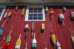 Bar Harbor, Maine (*Ken Lane*) Tags: geo:lat=4439117664 geo:lon=6820598960 geotagged unitedstates usa barharbor barharbormaine downtownbarharbor hancockcounty hancockcountymaine harborsidemarina maine mdi mountdesertisland nikon northeastatlantic northeastunitedstates northeasternunitedstates travel travelphotography upshot façade floats window redwall woodsiding buoy buoyant