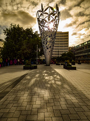 Morning Shadows (Steve Taylor (Photography)) Tags: art sculpture brown light sepia metal newzealand nz southisland canterbury cbd city cathedral silhouette shadow lensflare cloud sunny sun sunshine cone square