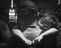 Daddy (John St John Photography) Tags: topoftherock 30rockefellercenter newyorkcity newyork daddy empirestatebuilding littlegirl tired sleeping father streetphotography candidphotography blackandwhite blackwhite bw monotone