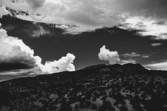 sadia bleak iii (Eric Baggett) Tags: newmexico sandiamountains bleak beautiful vast expansive sky mountains albuquerque solitude historicbuilding noiretblanc bnw blackandwhite blackandwhitelandscape sonya7rii clouds perspective