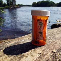 Genie in a RX bottle (mccs_10) Tags: white orange foundthings matches bottle prescriptionpills rx water riverside river