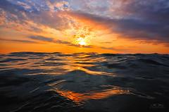 KSC_3289 (Kostas Kalomiris) Tags: sea sunset highlights colors water watercolors reflections afternoon waves horizon sky seascape heavysea clouds