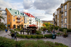 Mont Tremblant (Artur Staszewski) Tags: autumn mountains green fall colors clouds buildings town colorful warm day mt sunny location tourist tourists destination colourful condos popular tremblant mont crowds condominiums visited