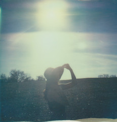 (Dependent on the Winds) Tags: portrait sky woman sun selfportrait film girl field silhouette female forest self polaroid sx70 woods feminine polaroids sunhat polaroidcamera instantfilm sunflares polaroidphotography polaroidpicture px70 impossibleproject