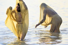 Gangasagar........For A Holy Dip (pallab seth) Tags: morning sea india colour festival religious island nikon women candid religion joy culture delta fair ritual tradition bathing custom devotee hindu hinduism bengal pilgrimage pilgrim ganga 2012 ganges mela sagar bayofbengal sunworship gangasagar holydip gangasagarmela corelpaintshopprox4 tamronaf70300mmf456dildmacrolens magicofreligion