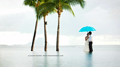Even rain is beautiful, when love is there (Pixelinthebox) Tags: blue sea color love pool rain umbrella couple honeymoon photographer lagoon amour palmtree mauritius infinitypool weddingphotographer lunedemiel ilemaurice pixelinthebox